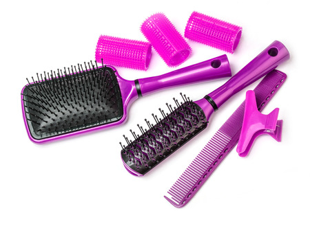 velcro: Curlers with hairbrush on white background Stock Photo