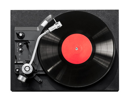 Top view of old fashioned turntable playing a track from black vinyl. Copy space for text