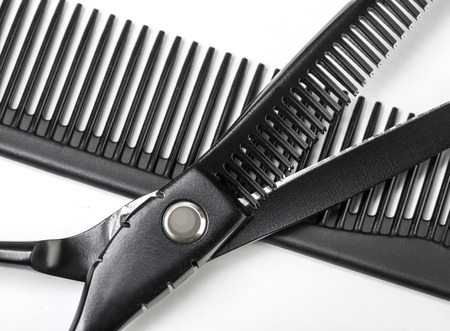 tapering: scissors for hairdresser operation and a hairbrush on white background