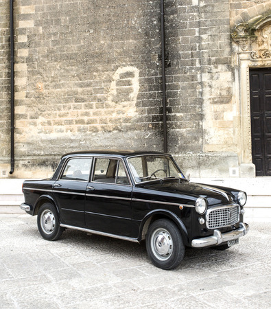old town: PUGLIA, ITALY-  MAY 02.2015.  Exhibition of old cars. Old black Fiat on a city street