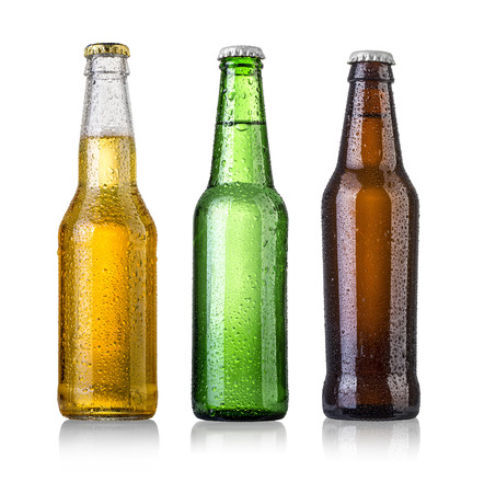 set of Beer bottles with water drops on white background.Five separate photos merged together. Foto de archivo