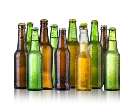 merged: set of Beer bottles with water drops anbd beer glasses on white background.Five separate photos merged together. Stock Photo