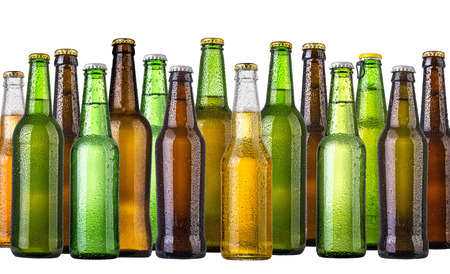 set of Beer bottles with water drops anbd beer glasses on white background.Five separate photos merged together. Foto de archivo