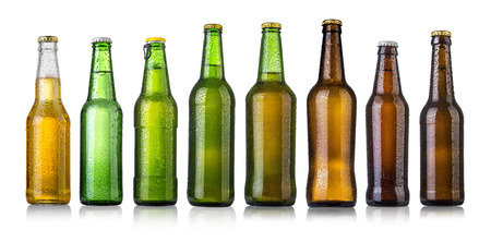 set of Beer bottles with water drops on white background.Five separate photos merged together. Stockfoto