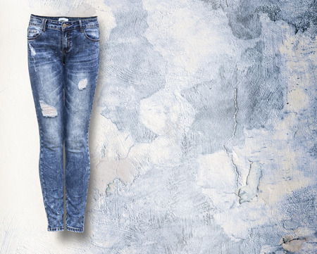 woman jeans in light light grunje background with copy space