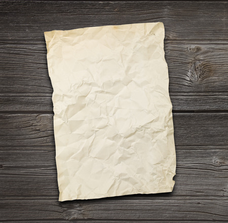 torn paper: old papers on a wooden table