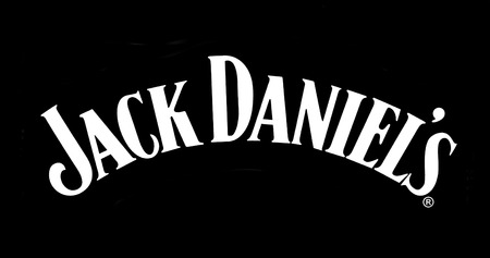 daniels: CHISINEU, MOLDOVA -NOVEMBER 14, 2015: Jack Daniels logo printed on paper and placed on black background. Jack Daniels is a brand of Tennessee whiskey that is the highest selling American whiskey
