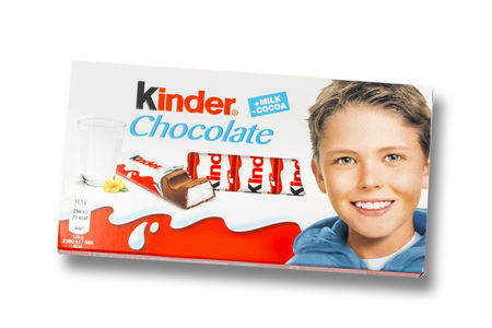 white bars: CHISINAU, MOLDOVA,NOVEMBER-14 , 2015:Kinder chocolate bars on white wooden background.Kinder bars are produced by Ferrero which was founded in 1946.