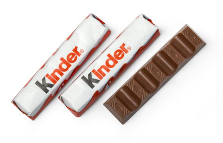 packshot: CHISINAU, MOLDOVA,  NOVEMBER-14 , 2015:Kinder chocolate bars on white wooden background.Kinder bars are produced by Ferrero which was founded in 1946. Editorial