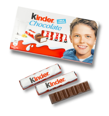 white bars: CHISINAU, MOLDOVA, NOVEMBER-14 , 2015:Kinder chocolate bars on white wooden background.Kinder bars are produced by Ferrero which was founded in 1946.