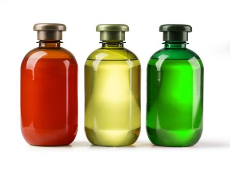 tres botellas champú sobre un fondo blanco Foto de archivo