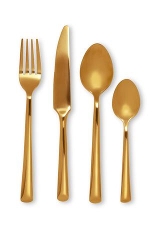 cuchara: Cubiertos de oro con Tenedor, cuchillo y cuchara en el fondo blanco Foto de archivo