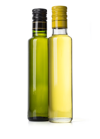 aceite de oliva: Two bottles of virgin olive oil on a white ground