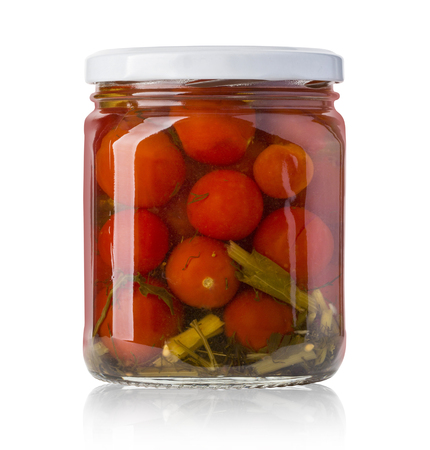 frasco: A glass jar of canned tomatoes on white background Foto de archivo