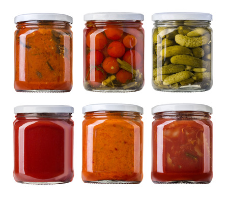 marinated gherkins: Preserved, pickled vegetables and food ingredients  in glass jars Stock Photo