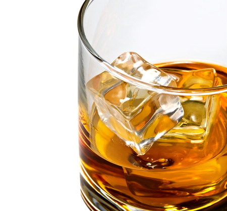 bourbon: Whiskey with ice in rocks glass detail shot Stock Photo