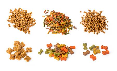 zoologico: un conjunto de alimentos para perros aislados en blanco. Foto de archivo