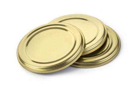glass jars: metal cover for closing of glass jars. The image on a white background. with clipping path