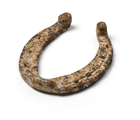Old horseshoe - a symbol of good luck on white background