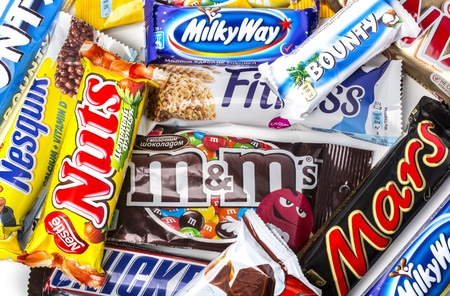 CHISINAU, MOLDOVA -  November 12, 2015: A pile of various chocolate bars, which some can be found in moldavian and some international. Editorial