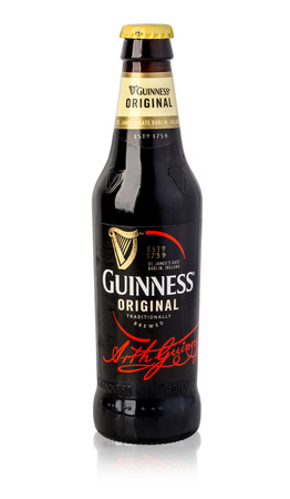 guinness beer: CHISINAU, MOLDOVA- November 14, 2015: Irish dry stout, originated in the brewery of Arthur Guinness, Dublin. One of the most successful beer brands in the world, available in over 100 countries.With clipping path