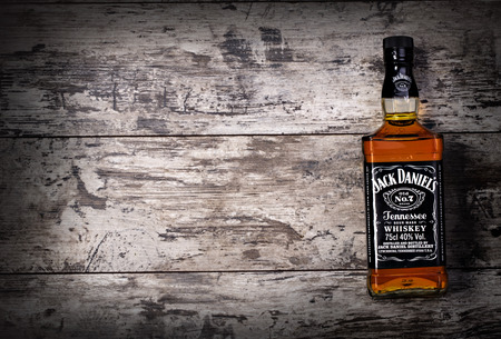 whiskey glass: CHISINAU, MOLDOVA- November 14. 2015.Photo of bottle of Jack Daniels Tennessee whiskey.Jack Daniels is a brand of sour mash Tennessee whiskey that is the highest selling American whiskey in the world