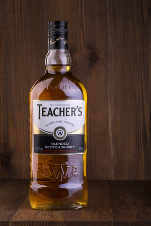scotch whisky: CHISINAU, MOLDOVA - FEBRUARY 05, 2016: Teachers Highland Cream Scotch whisky bottle macro isolated on white. Teachers Highland Cream is a brand of blended scotch whisky produced in Glasgow, Scotland.