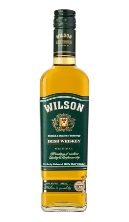 wilson: CHISINAU, MOLDOVA - December 25, 2015: BLENDED WHISKY WILSON. Whiskey created in classical Irish style. Perfectly balanced blend has a light amber color with a beautiful golden hue.