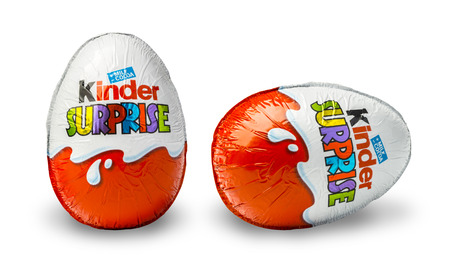 kinder: CHISINAU, MOLDOVA - November 14, 2015. Kinder Surprise, a chocolate egg containing a small toy for children, but also popular with adult collectors. Kinder Surprise eggs are manufactured by Ferrero. Editorial