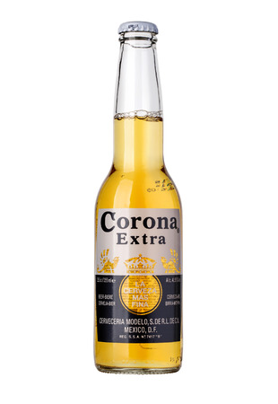 CHISINAU, MOLDOVA - January 04, 2016: Photo of a  bottle of Corona Extra Beer. Corona, produced by Grupo Modelo with Anheuser Busch InBev, is the most popular imported beer in the US. 報道画像