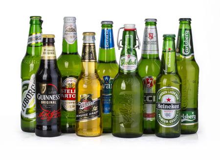 carlsberg: CHISINAU, MOLDOVA - December 05, 2015: 9 bottles of assorted cold beers. Imported brews including, Tuborg, Guinness, Stella Artoua, Miller, Bavaria, Grolsch, Becks, Heineken, Carlsberg
