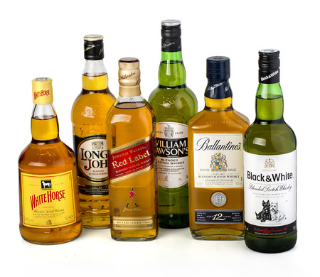 liquors: CHISINAU, MOLDOVA - January 27, 2016: Several types of bottled alcohol White Horse,Long John, Johny Walker, William Wilsons, Ballantines, Black&White.