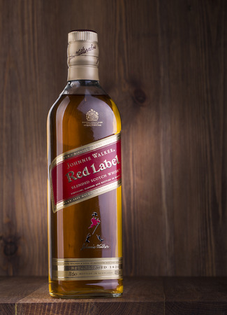 alcoholic beverages: CHISINAU, MOLDOVA -February 05, 2016: Johnnie Walker is the most widely distributed brand of blended Scotch whisky in the world with sales of over 130 million bottles a year.
