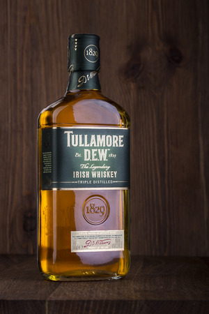 liter: CHISINAU, MOLDOVA - February 05, 2016.: One bottle of Tullamore Dew Irish Whiskey Triple Distilled 40% 1 Liter. Original blended Irish Whiskey distilled, matured and bottled in Ireland