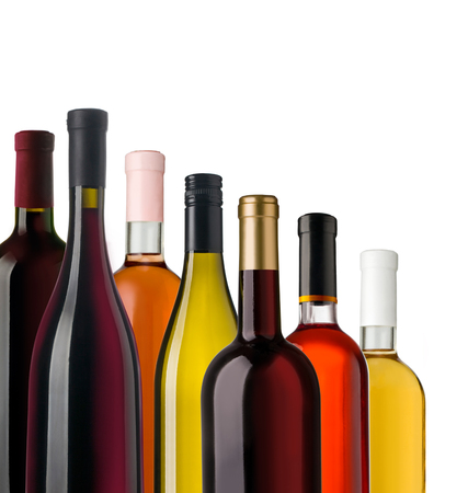 a bottle: Some wine bottles in front of white background