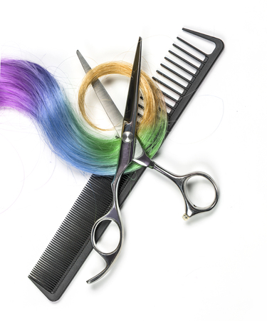 Long colored hair and scissors isolated on white background