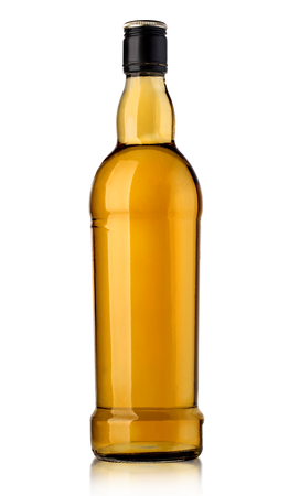rich flavor: whiskey bottl on white background Stock Photo
