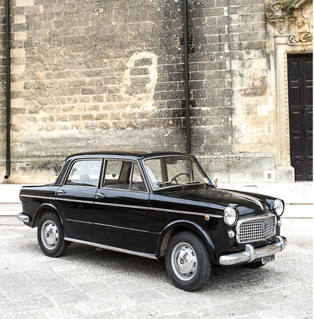 vintage car: PUGLIA, ITALY-  MAY 02.2015.  Exhibition of old cars. Old black Fiat on a city street