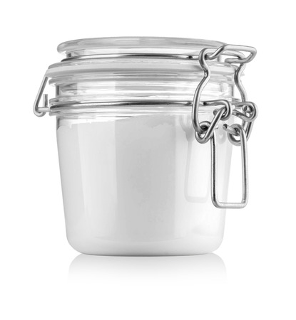 homeware: Glass Jar package with milk or cream on White Background