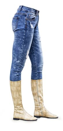 Legs in jeans and boots belongs to beautiful girl. Isolated on white background