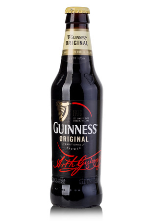guinness beer: CHISINAU, MOLDOVA - Ferbruary 05, 2016: A bottle of Guinness beer on a white background. Guinness is one of the most successful beer brands worldwide.