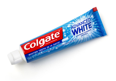 preventative: CHISINAU, MOLDOVA -March 13, 2016;: Colgate tooth paste on white.Colgate is a brand of toothpaste produced by Colgate-Palmolive Editorial