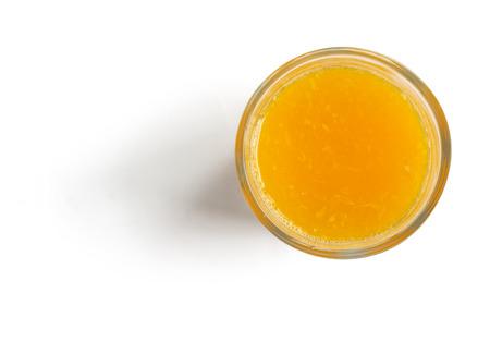 クリッピング パスのホワイト バック グラウンド トップ ビューで新鮮な l オレンジ ジュース 写真素材