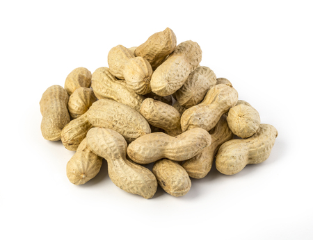 hard core: Peanuts on white ground isolated with clipping path Stock Photo