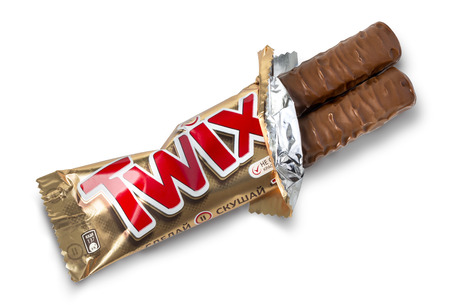 deliciously: Chisinau, Moldova -  . Octobe r05, 2015: Closeup of unwrapped Twix candy chocolate bar