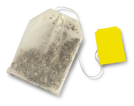 teabag: Teabag with yellow label. Top view. Isolated on a white. with clipping path