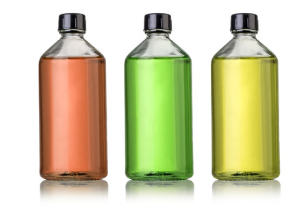 Three large glass bottles with medications.