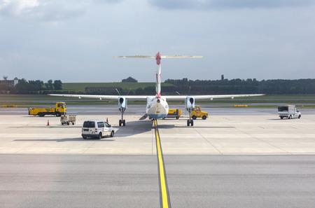 hubs: Vienna, Austria- May 11, 2016 Austrian Airlines  preparing for take-off in Vienna airport. Vienna airport is home for Austrian Airlines and one of biggest european hubs.