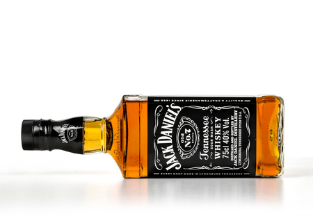 daniels: CHISINAU,MOLDOVA-NOVEMBER 14.2015: Single Botle of Jack Daniels # 7. Jack Daniels is a brand of Tennessee whiskey that is the highest selling American whiskey in MOLDOVA and all over the world.