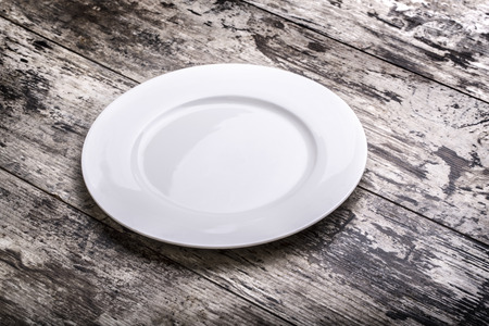 grunge flatware: Mock up white plate on white wooden table